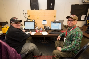 Volunteer Comms Darla Pindell and Jerry Trodden at the Nome headquarters during the 2016 Iditarod.  Alaska      Photo by Jeff Schultz (C) 2016  ALL RIGHTS RESERVED