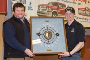 Matthew Macri, director of operations for PenAir presents Dallas Seavey with the PenAir Spirit of Alaska Award at the musher finisher's banquet in Nome during the 2016 Iditarod.  Alaska      Photo by Jeff Schultz (C) 2016  ALL RIGHTS RESERVED