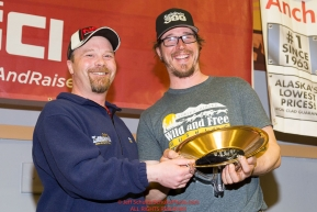 Aaron Burmeister, Official Finisher's Club president presents Brent Sass with the First Musher to Ophir Award at the musher finisher's banquet in Nome during the 2016 Iditarod.  Alaska      Photo by Jeff Schultz (C) 2016  ALL RIGHTS RESERVED