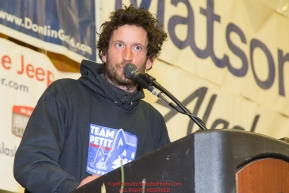 Nicolas Petit receives the Nome Kennel Club Fastest Time from Safety to Nome award at the musher finisher's banquet in Nome during the 2016 Iditarod.  Alaska      Photo by Jeff Schultz (C) 2016  ALL RIGHTS RESERVED