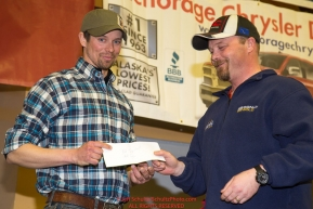 The Most Inspirational Musher Award is presented by Aaron Burmeister, IOFC President to Matt Failor at the musher finisher's banquet in Nome during the 2016 Iditarod.  Alaska      Photo by Jeff Schultz (C) 2016  ALL RIGHTS RESERVED