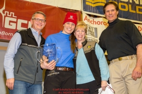 The Alaska Airlines Leonhard Seppala Humanitarian Award is presented by Marilyn Romano, regional vice president, and Tim Thompson, manager, external affairs, with Alaska Airlines and ITC chief veterinarian Stu Nelson to Aliy Zirkle at the musher finisher's banquet in Nome during the 2016 Iditarod.  Alaska      Photo by Jeff Schultz (C) 2016  ALL RIGHTS RESERVED