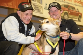 The City of Nome Lolly Medley Memorial Golden Harness Award is presented by Richard Beneville, mayor of Nome To Dallas Seavey's lead dog Reef at the musher finisher's banquet in Nome during the 2016 Iditarod.  Alaska      Photo by Jeff Schultz (C) 2016  ALL RIGHTS RESERVED