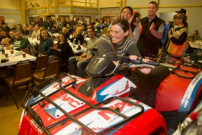 Musher Sigrid Ekran starts up and wins the Northern Air Cargo 4-wheeler giveaway at the musher awards banquet in Nome after the 2016 Iditarod.  Alaska      Photo by Jeff Schultz (C) 2016  ALL RIGHTS RESERVED