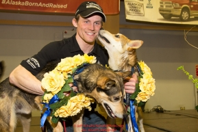 2016 Iditarod Champion Dallas Seavey poses with his lead dogs Reef and Tide at the musher awards banquet in Nome after the 2016 Iditarod.  Alaska      Photo by Jeff Schultz (C) 2016  ALL RIGHTS RESERVED