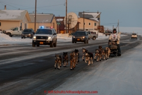 Steve Watkins runs down Front Street on his way to the finish line in Nome on Saturday March 21, 2015 during Iditarod 2015.  (C) Jeff Schultz/SchultzPhoto.com - ALL RIGHTS RESERVED DUPLICATION  PROHIBITED  WITHOUT  PERMISSION