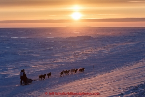 Mark Selland on the trail a few miles from Nome at sunset on Saturday March 21, 2015 during Iditarod 2015.  (C) Jeff Schultz/SchultzPhoto.com - ALL RIGHTS RESERVED DUPLICATION  PROHIBITED  WITHOUT  PERMISSION