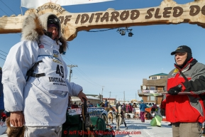 Laura Allaway at the finish line in Nome on Saturday March 21, 2015 during Iditarod 2015.  (C) Jeff Schultz/SchultzPhoto.com - ALL RIGHTS RESERVED DUPLICATION  PROHIBITED  WITHOUT  PERMISSION