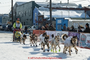 Monica Zappa runs into the chute at the finish line in Nome on Saturday March 21, 2015 during Iditarod 2015.  (C) Jeff Schultz/SchultzPhoto.com - ALL RIGHTS RESERVED DUPLICATION  PROHIBITED  WITHOUT  PERMISSION