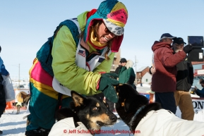 Monica Zappa Congratulates her dogs at the finish line in Nome on Saturday March 21, 2015 during Iditarod 2015.  (C) Jeff Schultz/SchultzPhoto.com - ALL RIGHTS RESERVED DUPLICATION  PROHIBITED  WITHOUT  PERMISSION