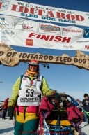 Monica Zappa poses for a photo at the finish line in Nome on Saturday March 21, 2015 during Iditarod 2015.  (C) Jeff Schultz/SchultzPhoto.com - ALL RIGHTS RESERVED DUPLICATION  PROHIBITED  WITHOUT  PERMISSION