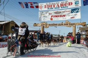 Heidi Sutter runs into the chute at the finish line in Nome on Saturday March 21, 2015 during Iditarod 2015.  (C) Jeff Schultz/SchultzPhoto.com - ALL RIGHTS RESERVED DUPLICATION  PROHIBITED  WITHOUT  PERMISSION