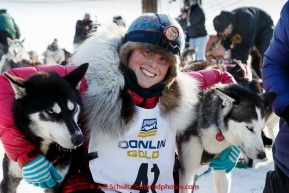 Lisbet Norris poses with her lead dogs at the finish line in Nome on Saturday March 21, 2015 during Iditarod 2015.  (C) Jeff Schultz/SchultzPhoto.com - ALL RIGHTS RESERVED DUPLICATION  PROHIBITED  WITHOUT  PERMISSION