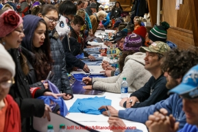 All the musher's who've finished the race as of Saturday March 21st are on hand at the Nome Mini-Convention Center to sign autographs for race fans during Iditarod 2015.  (C) Jeff Schultz/SchultzPhoto.com - ALL RIGHTS RESERVED DUPLICATION  PROHIBITED  WITHOUT  PERMISSION