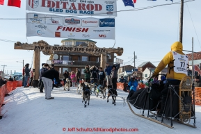 Alan Stevens runs across the finish line in Nome on Saturday March 21, 2015 during Iditarod 2015.  (C) Jeff Schultz/SchultzPhoto.com - ALL RIGHTS RESERVED DUPLICATION  PROHIBITED  WITHOUT  PERMISSION
