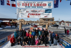 A portion of the mushers who finished the 2015 Iditarod as of 2pm on Saturday March 21st pose at the finish line in Nome for a group photo(C) Jeff Schultz/SchultzPhoto.com - ALL RIGHTS RESERVED DUPLICATION  PROHIBITED  WITHOUT  PERMISSION