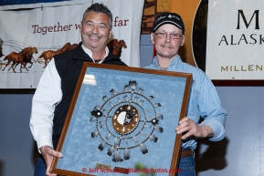 Mitch Seavey (L) recieves the PenAir Spirit of Alaska award from Danny Seybert of PenAir at the finishers banquet in Nome on Sunday  March 22, 2015 during Iditarod 2015.  (C) Jeff Schultz/SchultzPhoto.com - ALL RIGHTS RESERVED DUPLICATION  PROHIBITED  WITHOUT  PERMISSION