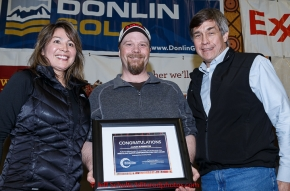 Aaron Burmeister (center) recieves the Bristol Bay Native Corporation Fish First award from Shawn Asplund and Andria Agli at the finishers banquet in Nome on Sunday  March 22, 2015 during Iditarod 2015.  (C) Jeff Schultz/SchultzPhoto.com - ALL RIGHTS RESERVED DUPLICATION  PROHIBITED  WITHOUT  PERMISSION