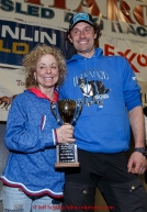 Thomas Waerner recieves the Jerry Austin Rookie of the year award from DeeDee Jonrowe at the finishers banquet in Nome on Sunday  March 22, 2015 during Iditarod 2015.  (C) Jeff Schultz/SchultzPhoto.com - ALL RIGHTS RESERVED DUPLICATION  PROHIBITED  WITHOUT  PERMISSION