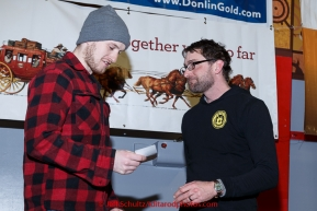 Wade Marrs recieves the Nome Kennel Club fastest time from from Safety award from Tom Jamgochian at the finishers banquet in Nome on Sunday  March 22, 2015 during Iditarod 2015.  (C) Jeff Schultz/SchultzPhoto.com - ALL RIGHTS RESERVED DUPLICATION  PROHIBITED  WITHOUT  PERMISSION