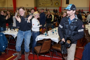 Lance Mackey gets a standing ovation from the crowd as he's announced as the Donlin Gold sportsmanship award winner at the finishers banquet in Nome on Sunday  March 22, 2015 during Iditarod 2015.  (C) Jeff Schultz/SchultzPhoto.com - ALL RIGHTS RESERVED DUPLICATION  PROHIBITED  WITHOUT  PERMISSION