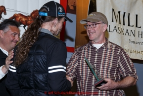 Lance Mackey (L) recieves the Donlin Gold sportsmanship award from Kurt Parkan at the finishers banquet in Nome on Sunday  March 22, 2015 during Iditarod 2015.  (C) Jeff Schultz/SchultzPhoto.com - ALL RIGHTS RESERVED DUPLICATION  PROHIBITED  WITHOUT  PERMISSION