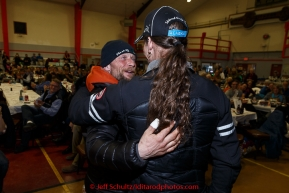 Brothers, Jason and Lance Mackey hug after they both recieved special sportsmanship awards at the finishers banquet in Nome on Sunday  March 22, 2015 during Iditarod 2015.  (C) Jeff Schultz/SchultzPhoto.com - ALL RIGHTS RESERVED DUPLICATION  PROHIBITED  WITHOUT  PERMISSION