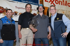 Nicolas Petit recieves the Alaska Airlnes Leonard Seppala Humanitarian Award from Pau G. Kosto, Stuart Nelson DVM --chief veterinarian, and Tim Thompson at the finishers banquet in Nome on Sunday  March 22, 2015 during Iditarod 2015.  (C) Jeff Schultz/SchultzPhoto.com - ALL RIGHTS RESERVED DUPLICATION  PROHIBITED  WITHOUT  PERMISSION
