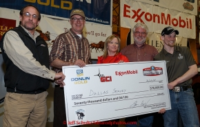 The four major Iditarod sponsors award the $70,000 winner check to 2015 Iditarod champion Dallas Seavey at the finishers banquet in Nome on Sunday  March 22, 2015 during Iditarod 2015.  (C) Jeff Schultz/SchultzPhoto.com - ALL RIGHTS RESERVED DUPLICATION  PROHIBITED  WITHOUT  PERMISSION