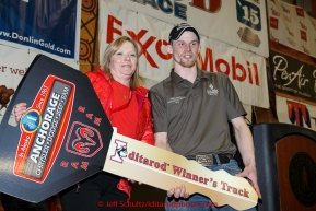 Anchorage Chrysler Dodge sponsor hads the keys to a new dodge pickup to 2015 Iditarod champion Dallas Seavey  at the finishers banquet in Nome on Sunday  March 22, 2015 during Iditarod 2015.  (C) Jeff Schultz/SchultzPhoto.com - ALL RIGHTS RESERVED DUPLICATION  PROHIBITED  WITHOUT  PERMISSION