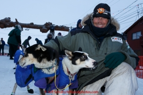Lachlan Clarke poses with his lead dogs in the finish chute at  Nome on Sunday  March 22, 2015 during Iditarod 2015.  (C) Jeff Schultz/SchultzPhoto.com - ALL RIGHTS RESERVED DUPLICATION  PROHIBITED  WITHOUT  PERMISSION