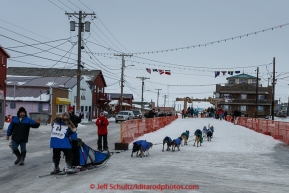 Cindy Gallea runs down Front Street into the finish chute in Nome on Sunday  March 22, 2015 during Iditarod 2015.  (C) Jeff Schultz/SchultzPhoto.com - ALL RIGHTS RESERVED DUPLICATION  PROHIBITED  WITHOUT  PERMISSION