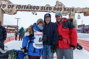 After finishing the race, Cindy Gallea poses at the finish line with her father Jim and her son Jim in Nome on Sunday  March 22, 2015 during Iditarod 2015.  (C) Jeff Schultz/SchultzPhoto.com - ALL RIGHTS RESERVED DUPLICATION  PROHIBITED  WITHOUT  PERMISSION