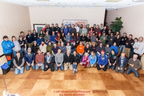 The entire field of 72 Iditarod mushers pose for a group photo at the mandatory musher meeting at the Lakefront Anchorage hotel on Thursday March 2, 2017 prior to the start of the 2017 Iditarod.Photo by Jeff Schultz/SchultzPhoto.com  (C) 2017  ALL RIGHTS RESVERVED