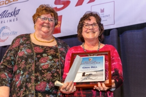 Iditarod Foundation member, Gail Phillips (left) gives the