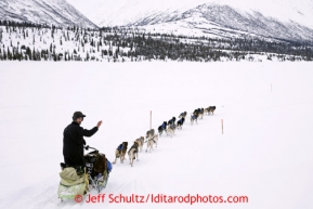 Nicolais Petit runs down the hill onto Puntilla Lake just before the  Rainy Pass checkpoint March 4, 2013.