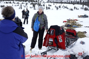 Kate Geary takes photos of Maggie Purves of Oregon at Rainy Pass checkpoint March 4, 2013.