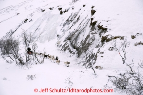 Paul Gebhart runs through a cut bank along Pass Creek after going over Rainy Pass during the 2013 Iditarod sled Dog Race   March 4, 2013.  Photo by Jeff Schultz Do Not Reproduce without permission