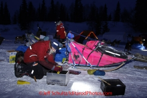 Monday March 5, 2012  A musher pours Heet into a cooker at the Finger Lake checkpoint during Iditarod 2012.