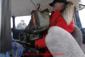 Thursday March, 2012    Volunteer Iditarod pilot Jerry Wortley packs his passenger&#039;s cargo in his Cessna 180 plane at the Takotna checkpoint.   Iditarod 2012.