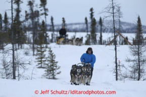 Travis Beals leads Matt Giblin on the trail into the halfway checkpoint of Iditarod on Friday March 8, 2013.Iditarod Sled Dog Race 2013Photo by Jeff Schultz copyright 2013 DO NOT REPRODUCE WITHOUT PERMISSION