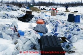 Trash and food bags line the bank of the Iditarod river at the halfway checkpoint of Iditarod on Friday March 8, 2013.Iditarod Sled Dog Race 2013Photo by Jeff Schultz copyright 2013 DO NOT REPRODUCE WITHOUT PERMISSION