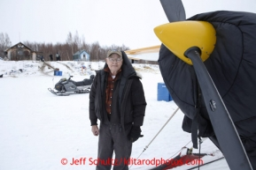 Pilot Jim Kintz waits for a load of dropped dogs at the halfway checkpoint of Iditarod on Friday March 8, 2013.Iditarod Sled Dog Race 2013Photo by Jeff Schultz copyright 2013 DO NOT REPRODUCE WITHOUT PERMISSION