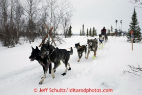 Jodi Bailey runs on the trail into the halfway checkpoint of Iditarod on Friday March 8, 2013.Iditarod Sled Dog Race 2013Photo by Jeff Schultz copyright 2013 DO NOT REPRODUCE WITHOUT PERMISSION