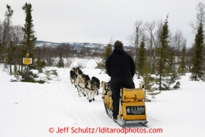 Matt Giblin passes a BLM sign for IDITAROD (City) on the trail into the halfway checkpoint of Iditarod on Friday March 8, 2013.Iditarod Sled Dog Race 2013Photo by Jeff Schultz copyright 2013 DO NOT REPRODUCE WITHOUT PERMISSION