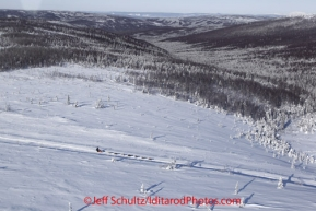 Friday March 9, 2012 Unknown musher and dog team on the way from the Cripple checkpoint to  the Yukon River village of Ruby, Alaska. Iditarod 2012.
