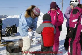Friday March 9, 2012  DeeDee Jonrowe signs autographs for kids at the Yukon River village of Ruby, Alaska. Iditarod 2012.