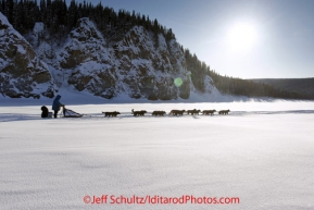 Friday March 9, 2012  John Baker runs on the Yukon River shortly after leaving the village of Ruby, Alaska. Iditarod 2012.