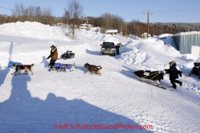 Friday March 9, 2012  Anjanette Steer runs behind her sled to make a wide turn to a parking spot as she arrives in the Yukon River village of Ruby, Alaska. Iditarod 2012.