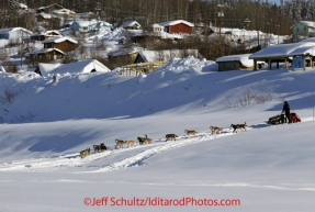 Friday March 9, 2012  Dallas Seavey runs down the bank onto the the Yukon River at the village of Ruby, Alaska. Iditarod 2012.